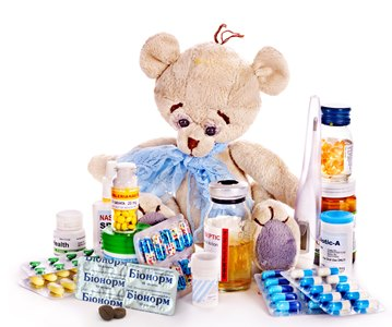 Child medicine and teddy bear.